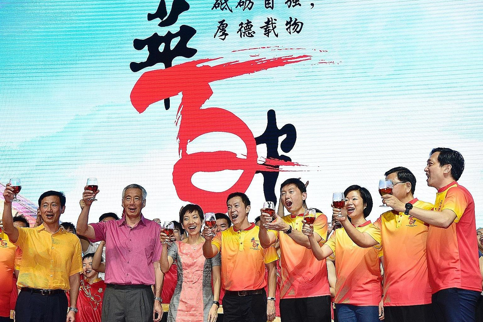 Prime Minister Lee Hsien Loong raising a ceremonial toast at Hwa Chong Institution's 100th anniversary gala dinner yesterday. With him were (from far left) Minister for Education Ong Ye Kung; Minister for Culture, Community and Youth Grace Fu; MP Lim
