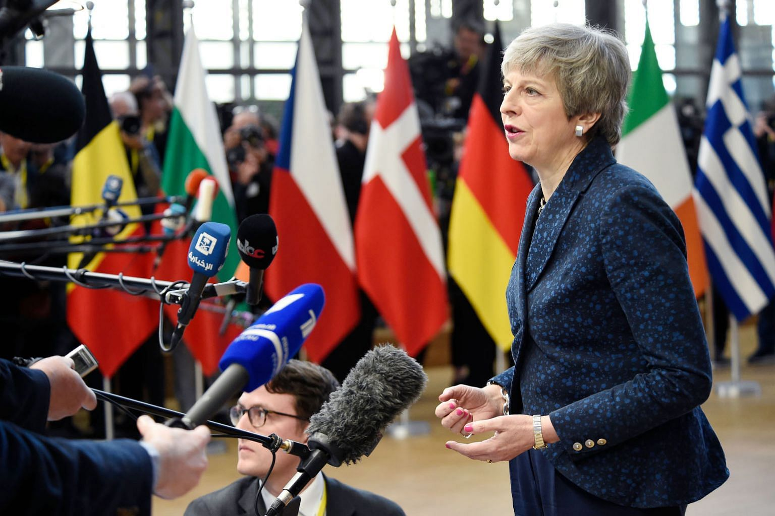 British Prime Minister Theresa May speaking to the press as she arrived yesterday in Brussels on the first day of an EU summit. Mrs May made a last-ditch plea to the bloc's 27 other leaders to hand her a Brexit delay until June 30, a request that she