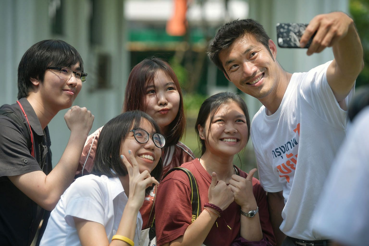 Mr Thanathorn Juangroong-ruangkit, leader of the Future Forward Party, with some students while campaigning at the King Mongkut's University of Technology Thonburi. Mr Chadchart Sittipunt, one of the Pheu Thai party's prime ministerial candidates, wi