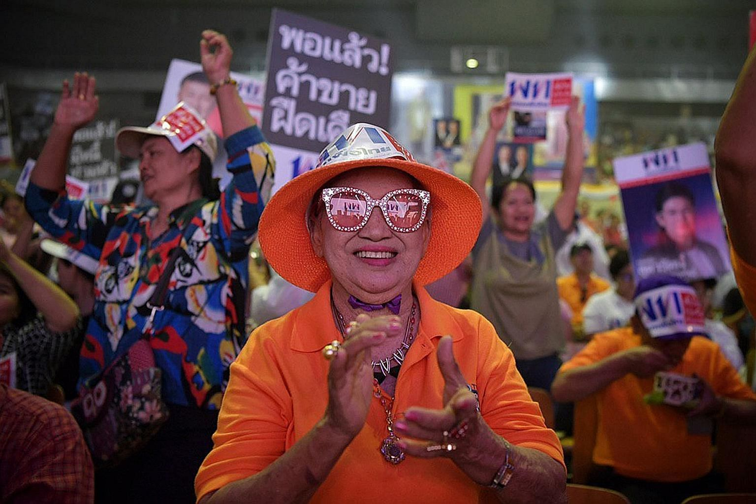 Pheu Thai supporters attending the party's rally at an indoor stadium in the Thai-Japan Youth Centre in Bangkok yesterday. Although analysts expect Pheu Thai and the Democrat Party to win the most number of seats, the odds are stacked heavily in favo