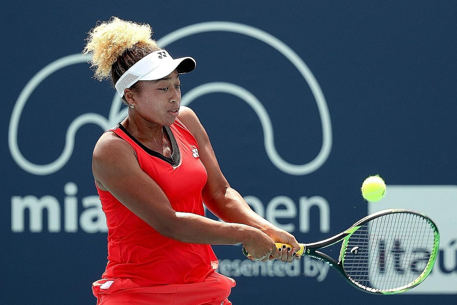 Mari Osaka returning a shot to fellow wild card Whitney Osuigwe during the Miami Open at Hard Rock Stadium on Thursday in Miami Gardens, Florida. Mari acquitted herself well despite a 6-2, 6-4 loss.