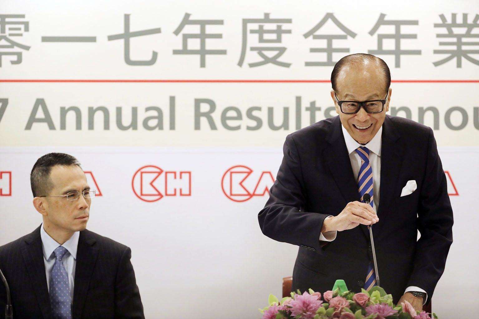 CK Hutchison Holdings' then chairman Li Ka Shing, accompanied by his son Victor, speaking at a Hong Kong news conference in March last year to announce his retirement and intention to hand over the top position to Mr Victor Li. In the year since his