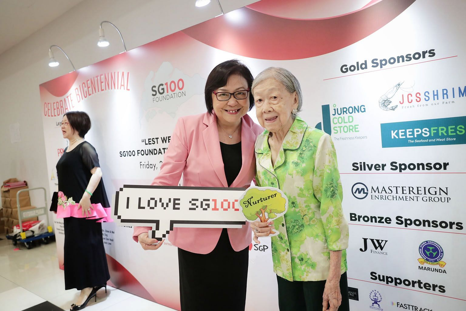 Dr Lillian Koh, 58, and her mother, Madam Goh Sock Chin, 99, at the SG100 Foundation dinner yesterday. Madam Goh was treated for a hip fracture and pneumonia last year but she remains in high spirits and is looking forward to her 100th birthday soon.
