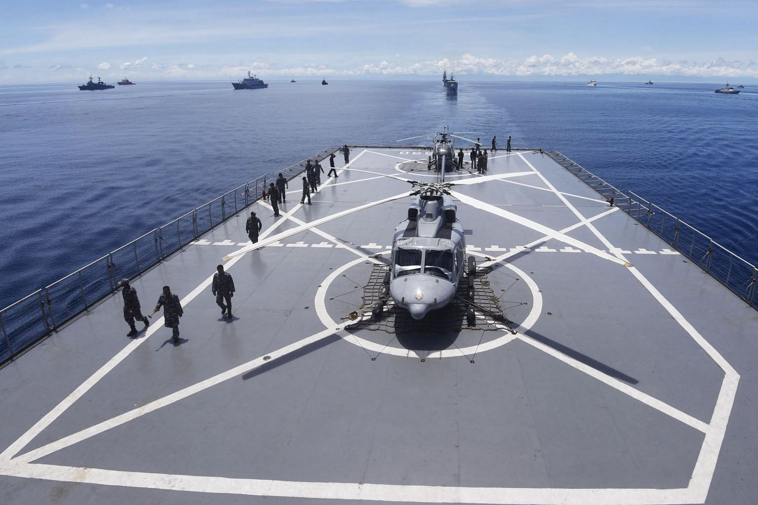 Navy helicopters on an Indonesian ship near the Mentawai Islands off the coast of West Sumatra, during the multinational Komodo exercise in 2016. According to the writer, Indonesia's maritime strategy could, and should, straddle the attractions of th