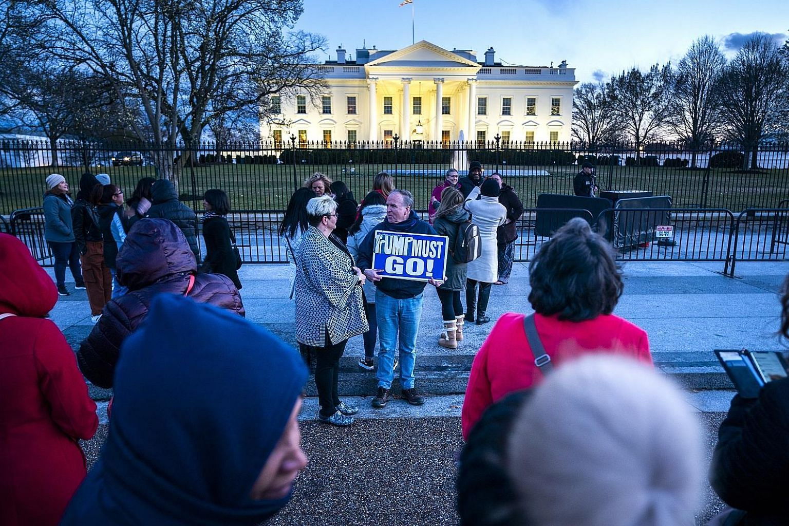 People gathering outside the White House at dusk after Special Counsel Robert Mueller delivered his report on Russia's interference in the 2016 US presidential election to the Department of Justice on Friday. A February poll by the Washington Post fo