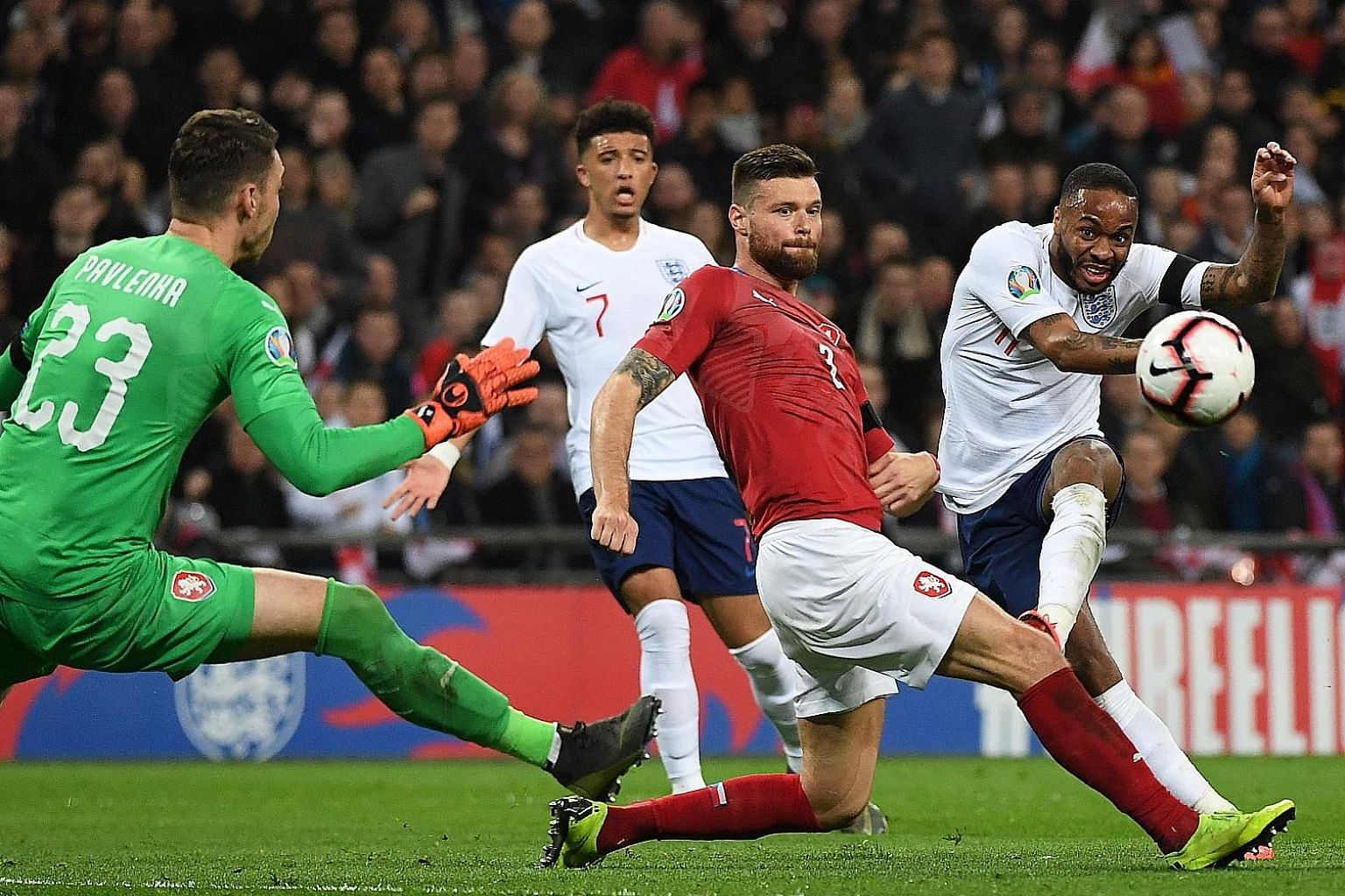 Raheem Sterling curling the ball around defender Ondrej Celustka and goalkeeper Jiri Pavlenka for his second goal to put England 3-0 up against the Czech Republic in their Euro qualifier at Wembley on Friday.