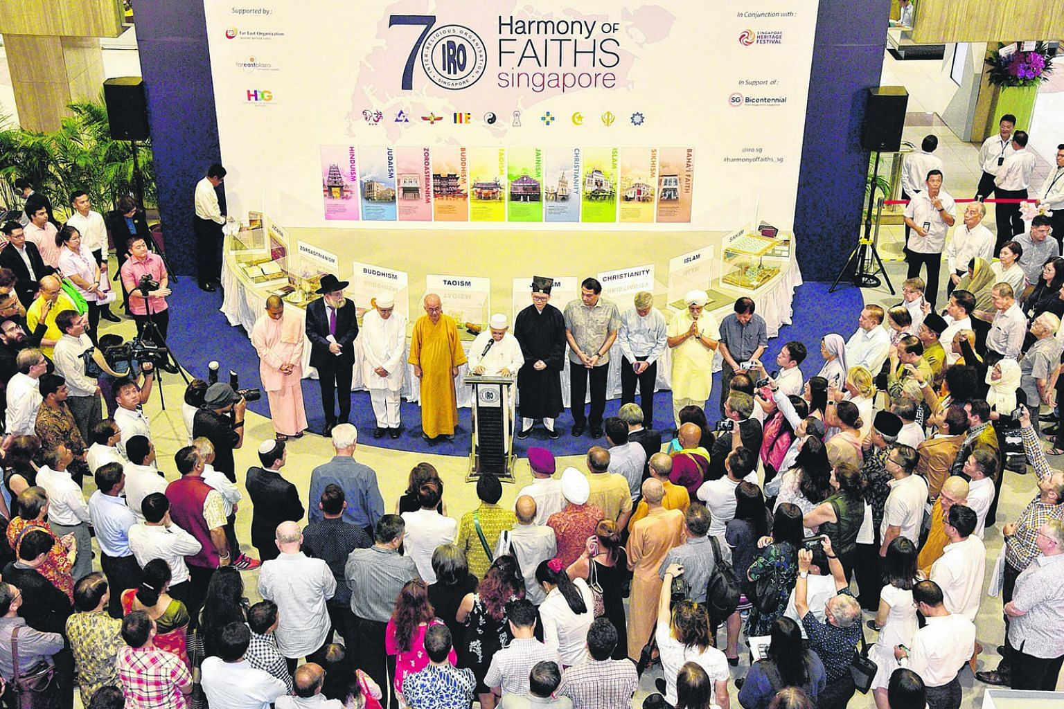 Interfaith prayers being held during the 70th anniversary of the founding of Inter-Religious Organisation, Singapore at Far East Plaza on March 18 last year. The Government has long stressed the values of multiculturalism and interfaith dialogue and