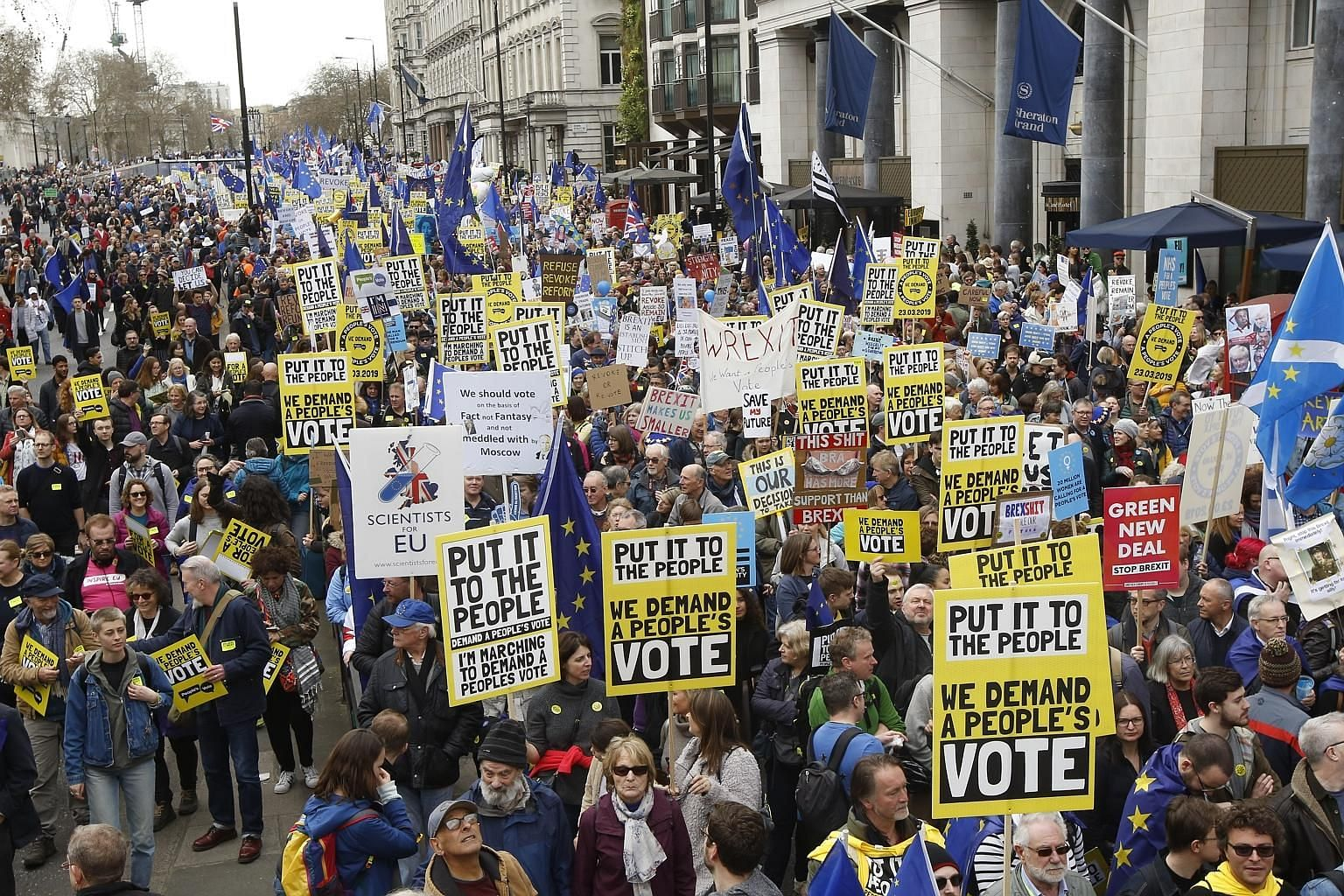 "Demonstrators marching in London last Saturday calling for a ""People's Vote"" on British Prime Minister Theresa May's Brexit deal. A poll released last Thursday found that if Parliament rejects Mrs May's deal for a third time, 46 per cent of responden"