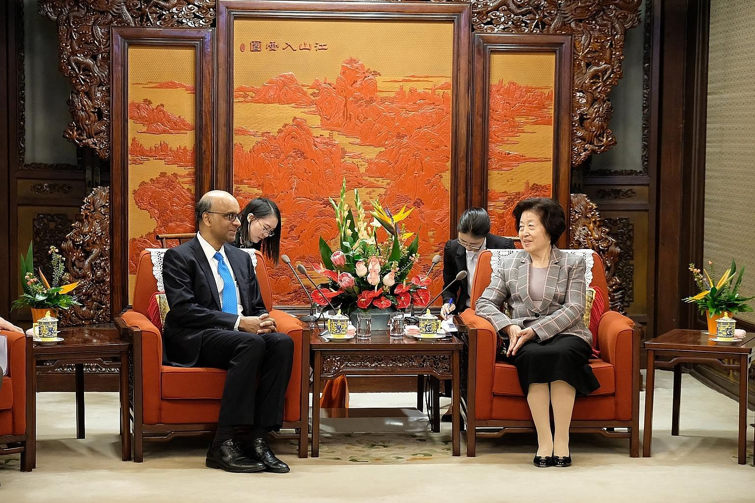 """Singapore Deputy Prime Minister Tharman Shanmugaratnam with Chinese Vice-Premier Sun Chunlan at the Hall of Purple Light in Beijing yesterday. Madam Sun said China and Singapore are """"friendly neighbours and critical cooperation partners"""", and that Mr"""
