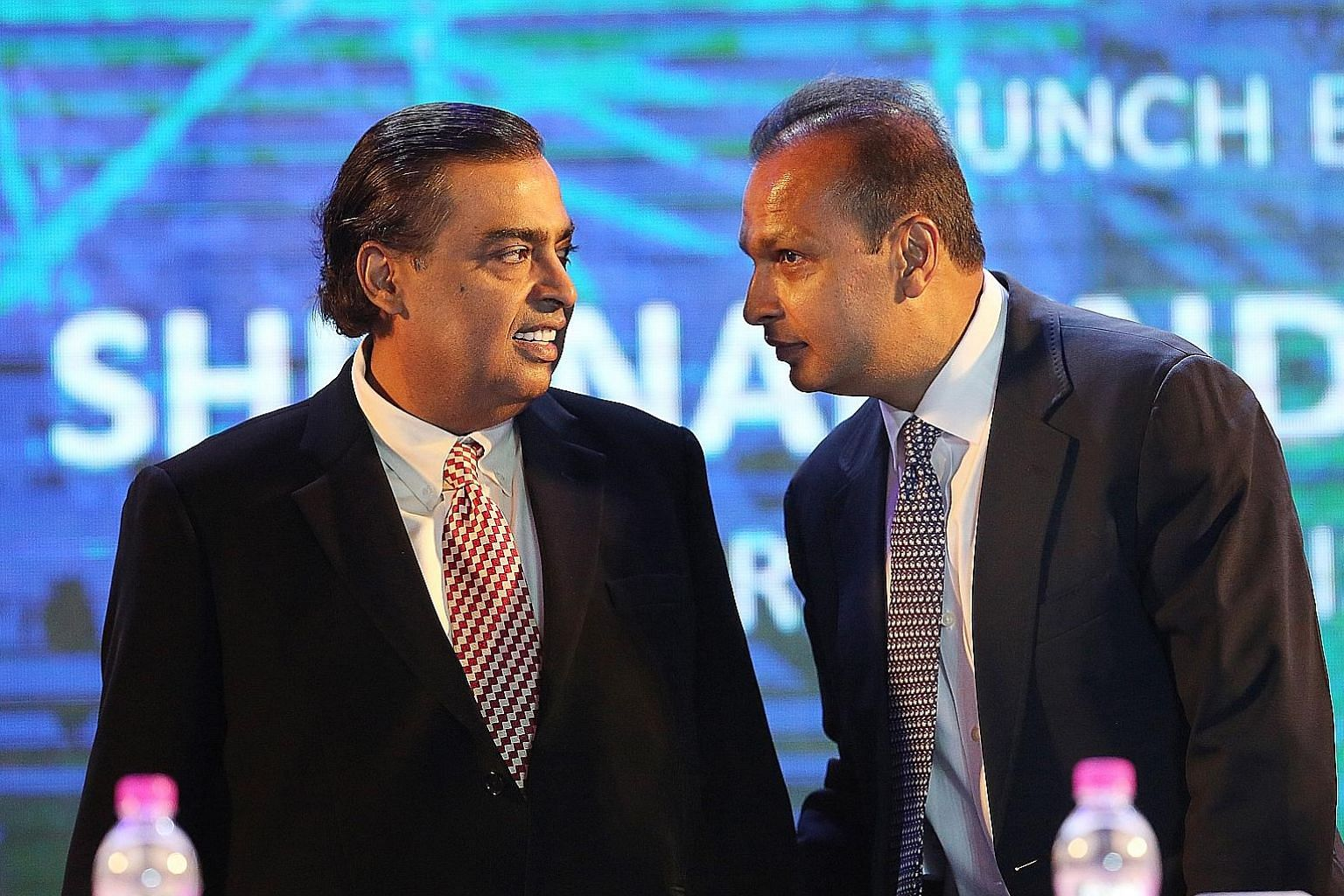 Reliance Industries chairman Mukesh Ambani (left) last week settled a 5.8 billion rupee (S$114 million) debt owed to Sweden's Ericsson by his younger brother Anil over a telecommunications contract that soured partly because Anil's Reliance Communica