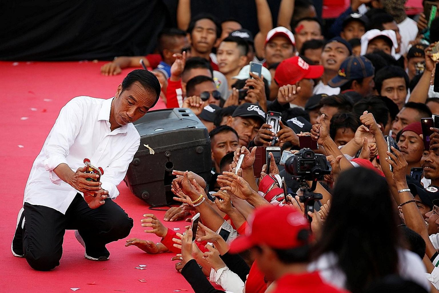 Mr Joko Widodo (top) campaigning in Serang, Banten province, on Sunday. Mr Prabowo Subianto (above) greeting supporters at his rally in Bandung, West Java province, on Thursday. Tonight's debate is the fourth in a series of five leading up to the Apr