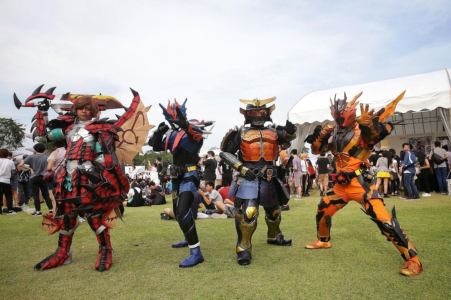Cosplayers dressed up as a Japanese schoolgirl (above), as well as Ryuk (left) from anime Death Note, and characters (from far left) Monster Hunter, Kamen Rider Cross-Z, SIC Kamen Rider Gaim and Kamen Rider Cross-Z Magma striking a pose at the Sakura