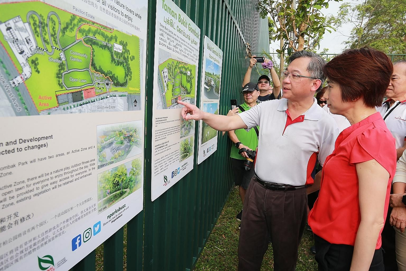 Health Minister Gan Kim Yong and Senior Parliamentary Secretary for Education and Manpower Low Yen Ling looking at a map of the upcoming Bukit Gombak Park, which will have a 400m walking trail and features such as a community garden and dog run.
