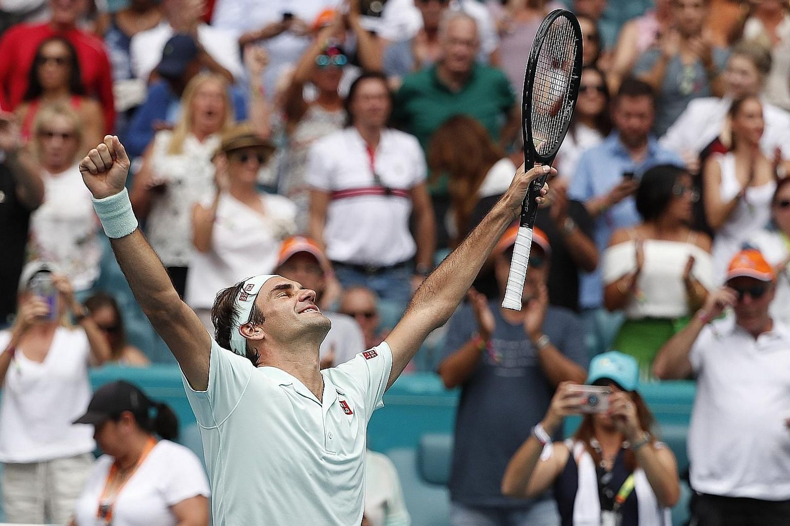 Roger Federer of Switzerland celebrating his 6-1, 6-4 victory over American John Isner in the Miami Open final on Sunday. It was his 101st career title and fourth in the tournament.