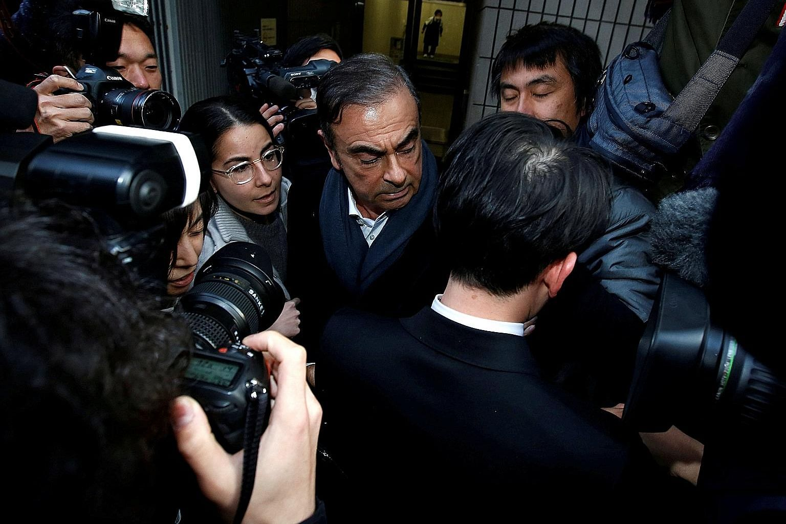 Former Nissan chairman Carlos Ghosn (left) leaving the office of his lead lawyer Junichiro Hironaka (above), in Tokyo last month. Mr Hironaka said the court plans to try Ghosn, Nissan and the tycoon's former right-hand man Greg Kelly together, and he