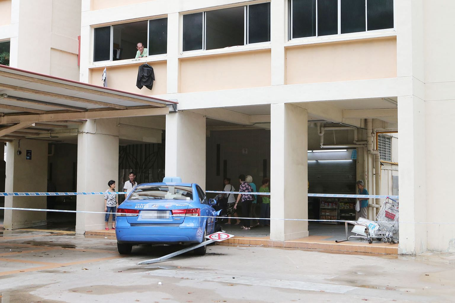 After the collision between the two cabs, the Comfort taxi had mounted the pavement before coming to a stop at the void desk of Block 175 in Toa Payoh Lorong 2. A ComfortDelGro spokesman said there were no passengers on board the Comfort taxi and no