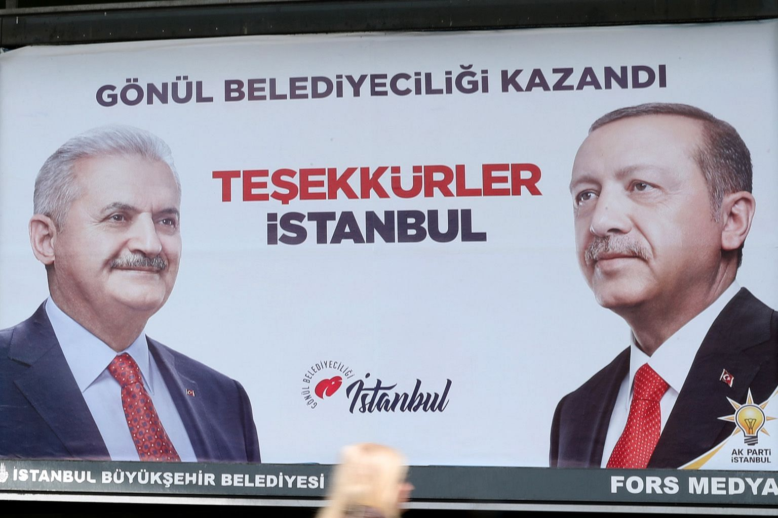 A banner with pictures of Turkey's ruling Justice and Development Party mayoral candidate in Istanbul Binali Yildirim (far left) and President Recep Tayyip Erdogan. Local election results yesterday showed a narrow lead for the main opposition candida