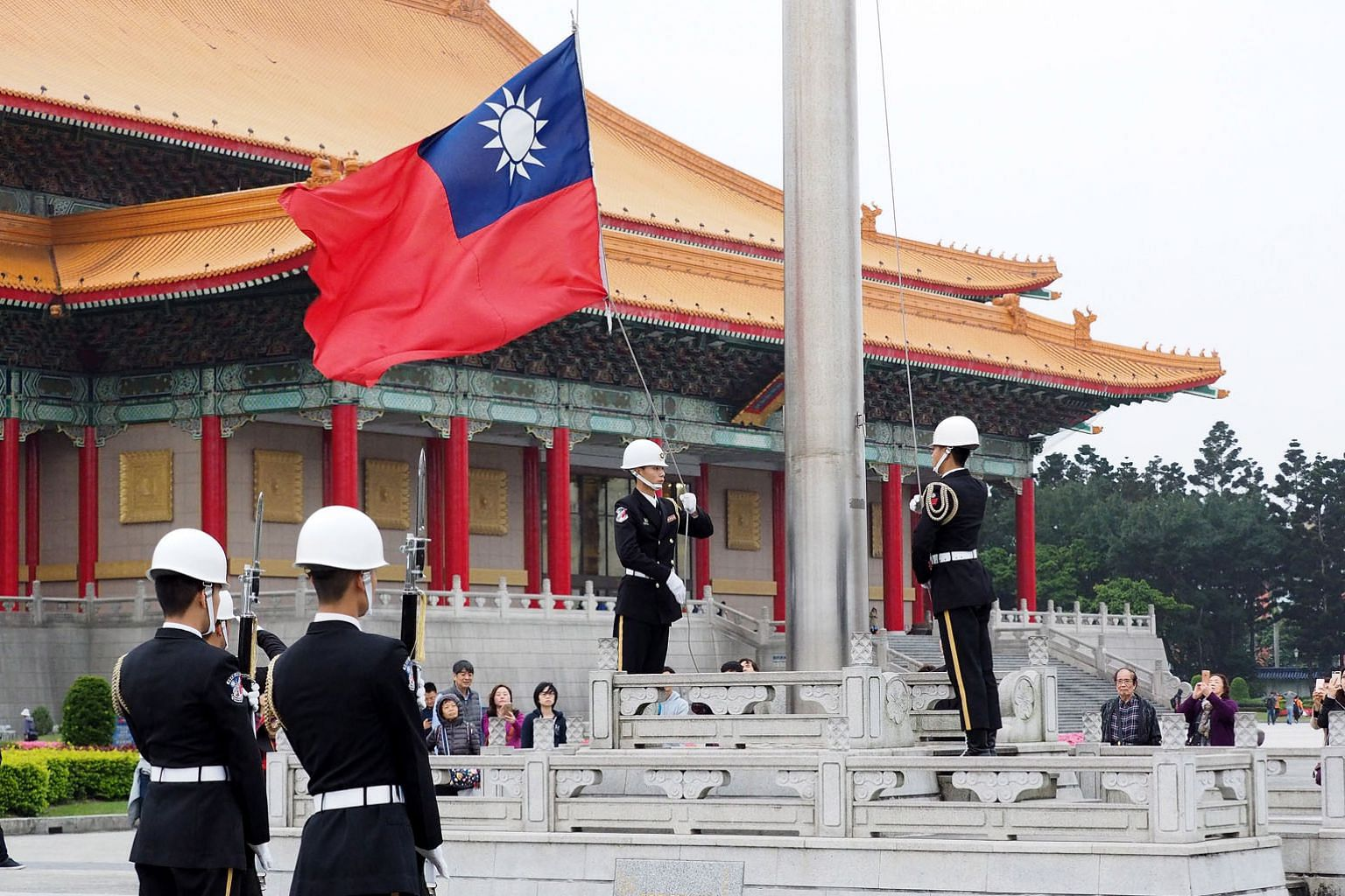 Taiwanese soldiers lowering the island's flag at Liberty Square in Taipei early last month. Taiwan's Presidential Office on Sunday condemned two Chinese warplanes' flight into Taiwan's air space.
