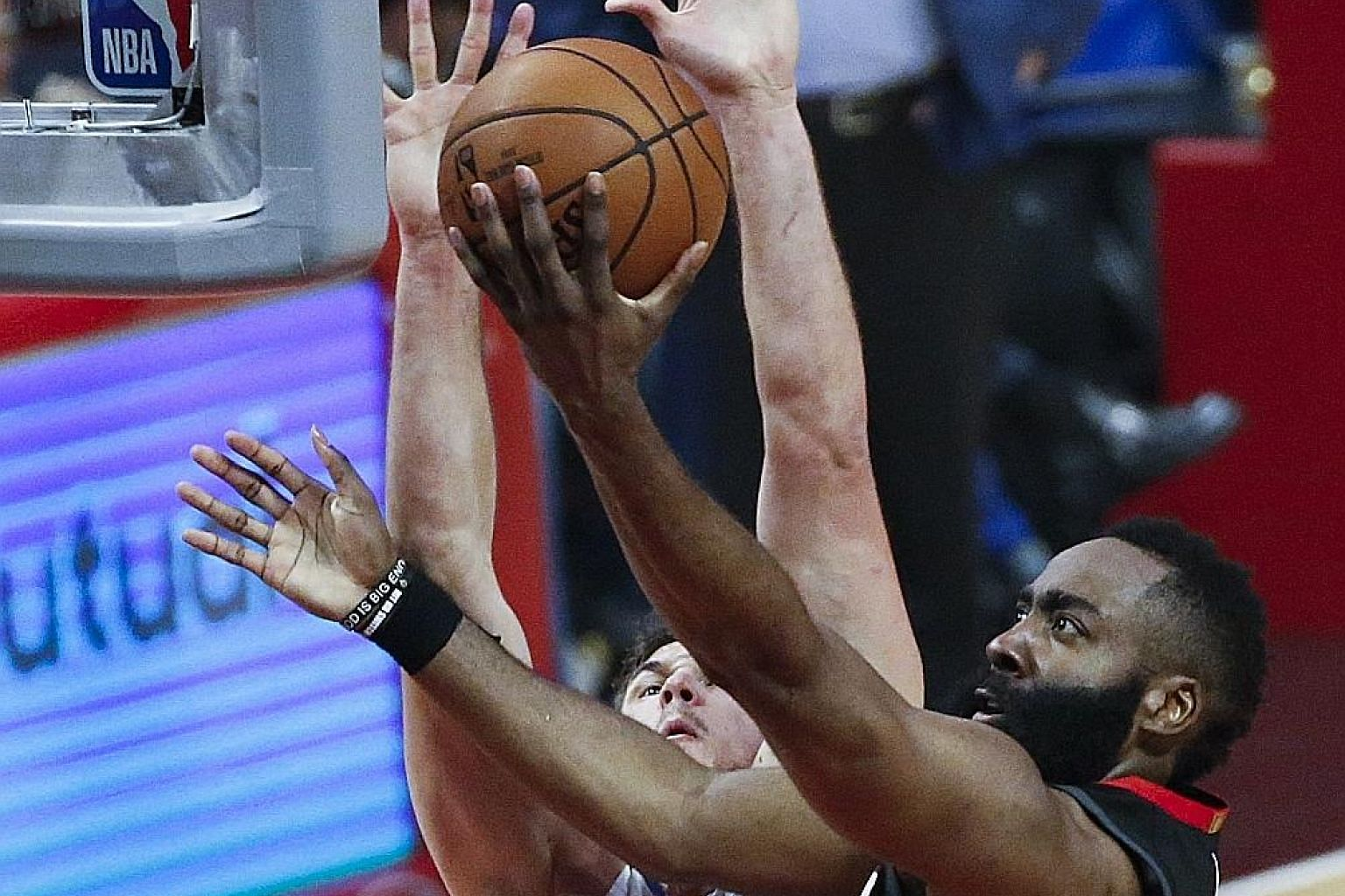 Houston Rockets star James Harden going for a basket as the LA Clippers' Danilo Gallinari blocks him in their NBA game at the Staples Centre on Wednesday.