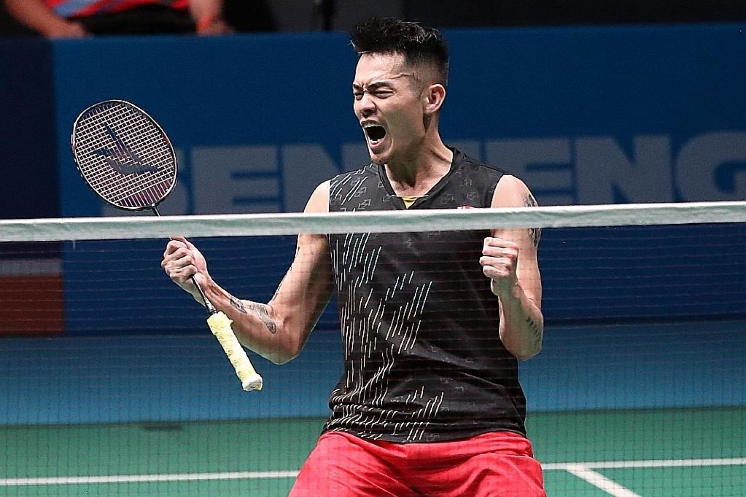 Chinese veteran Lin Dan is thrilled after upsetting Chinese Taipei third seed Chou Tien-chen in the first round of the Malaysia Open on Wednesday. He needs to overtake one of his two higher-ranked teammates to stand a chance of playing in his fifth O