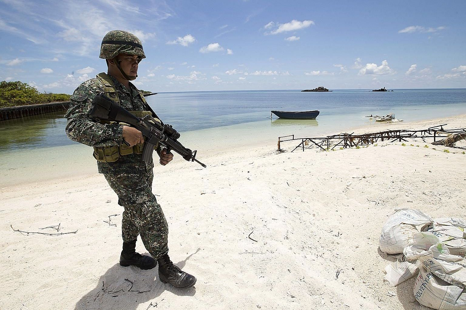 "A Filipino soldier patrolling Thitu Island, which is part of the Spratlys, in the South China Sea in 2015. The Philippine Foreign Ministry called China's actions ""a clear violation of Philippine sovereignty, sovereign rights and jurisdiction"", in a s"