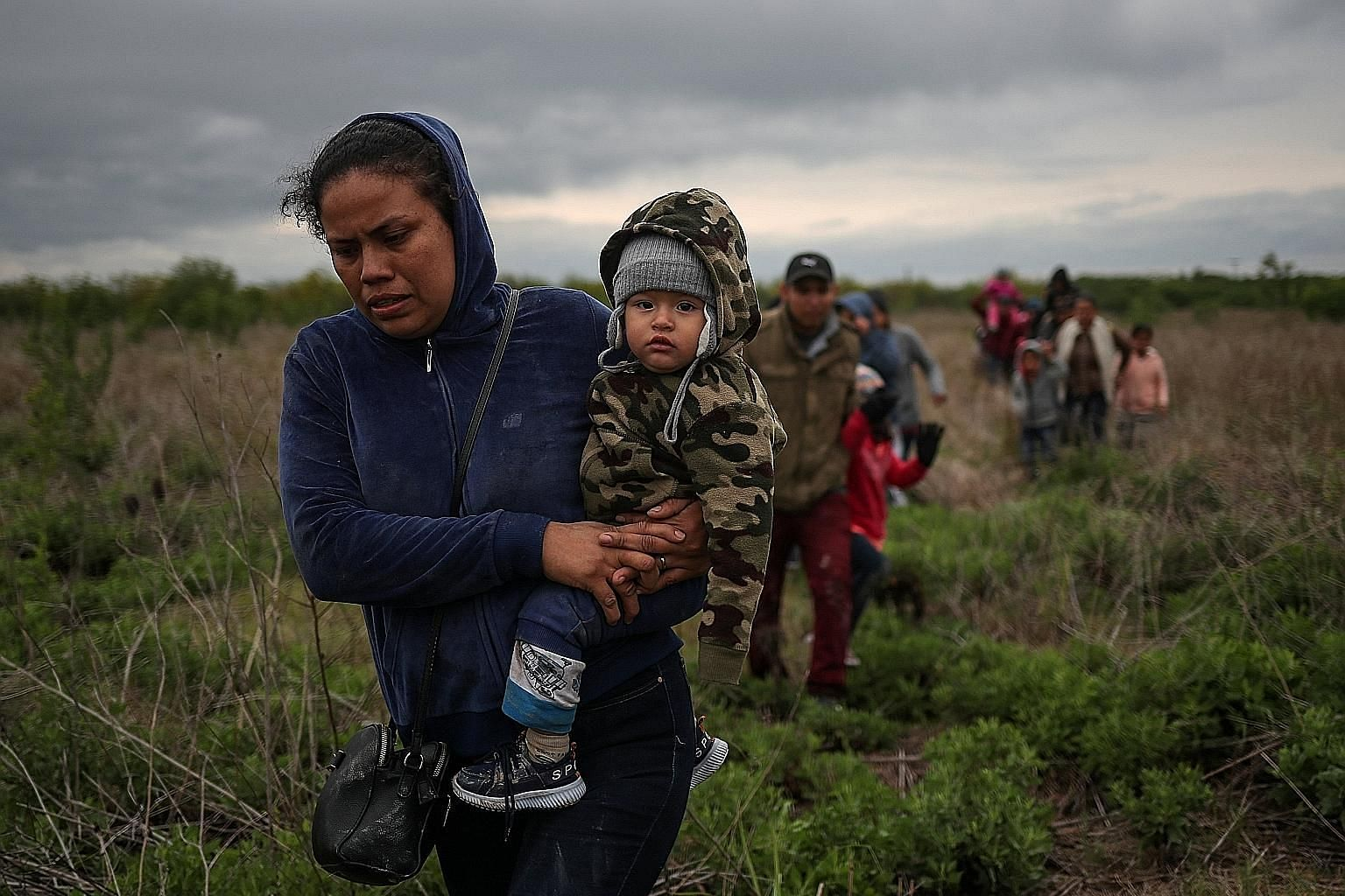A mother and child from El Salvador, together with other asylum seekers, after crossing the Rio Grande illegally into the US from Mexico late last month.