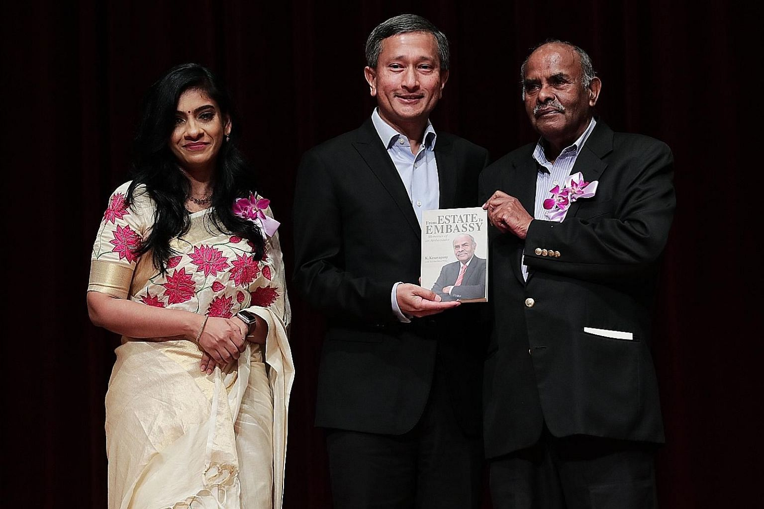 Foreign Minister Vivian Balakrishnan and veteran diplomat K. Kesavapany (right) at the launch of the former high commissioner's biography. The book is co-authored by applied linguist Anitha Devi Pillai (left).