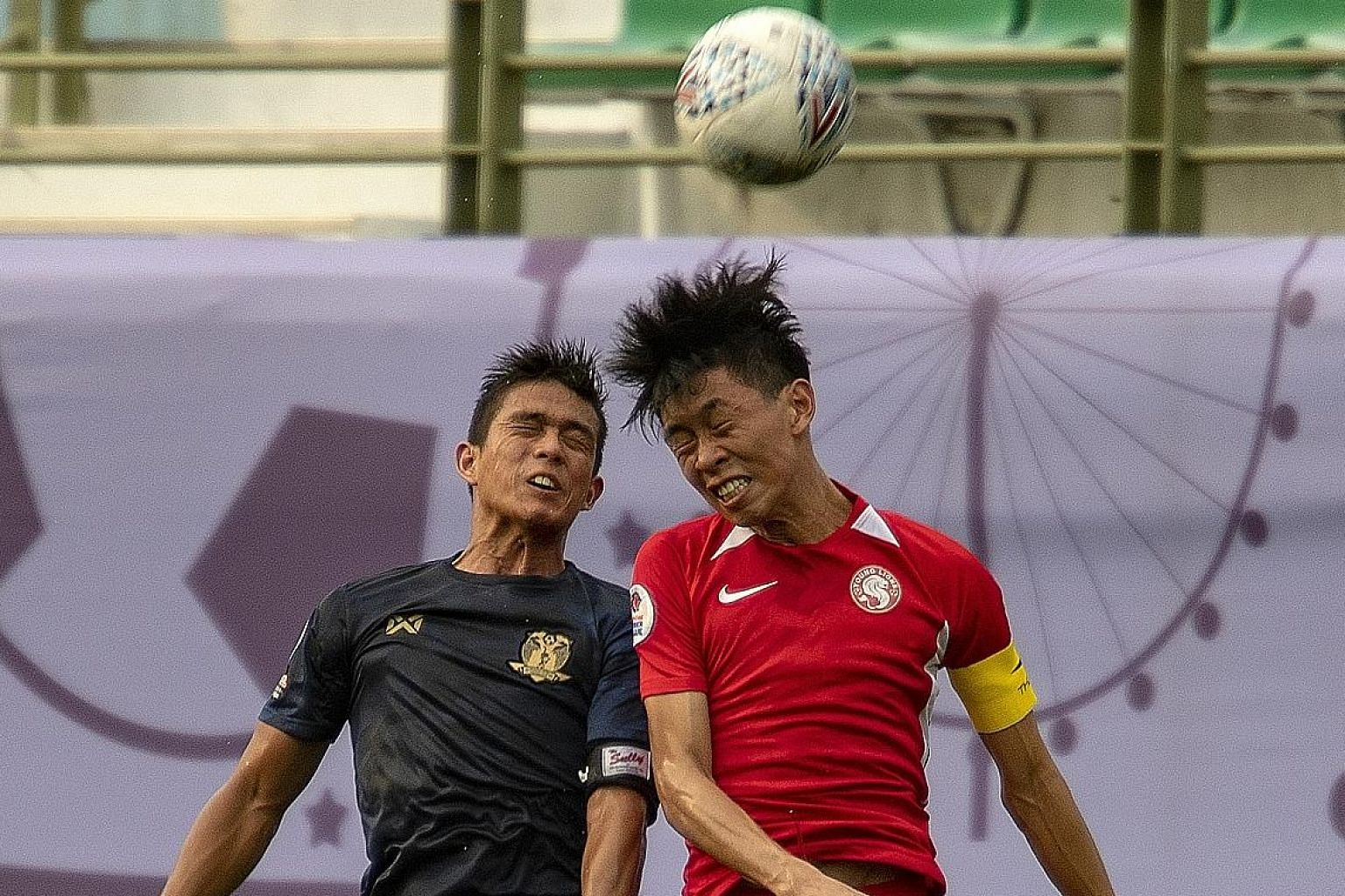 Young Lions captain Joshua Pereira challenging Hougang United's Hafiz Sujad in their 2-1 Singapore Premier League win last Sunday.