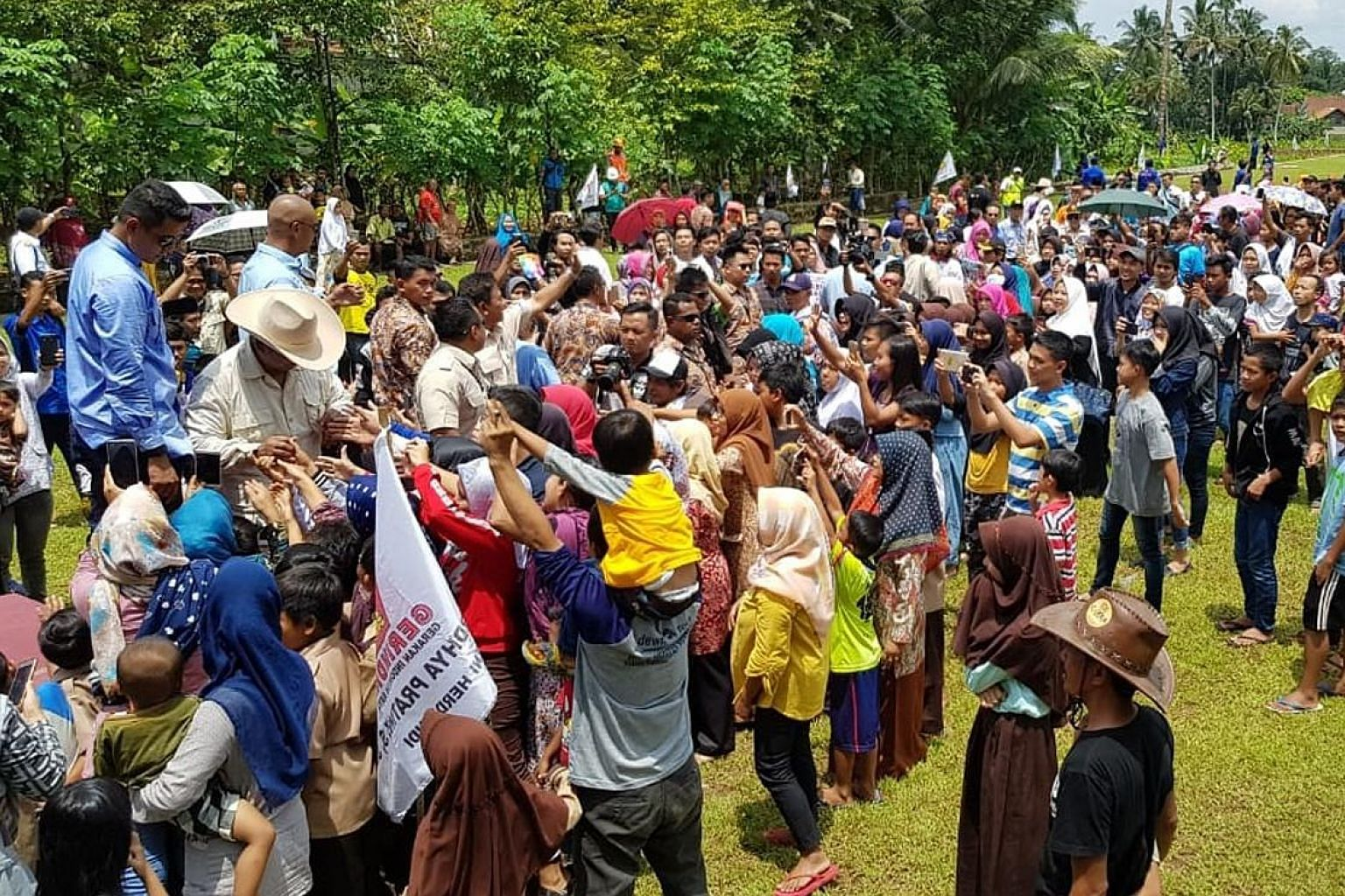 Mr Prabowo speaking in Ciamis yesterday, where he promised, if elected, to cut electricity costs within his first 100 days in office. A crowd bidding farewell to Mr Prabowo Subianto in Ciamis regency after his campaign stop there yesterday. The modes