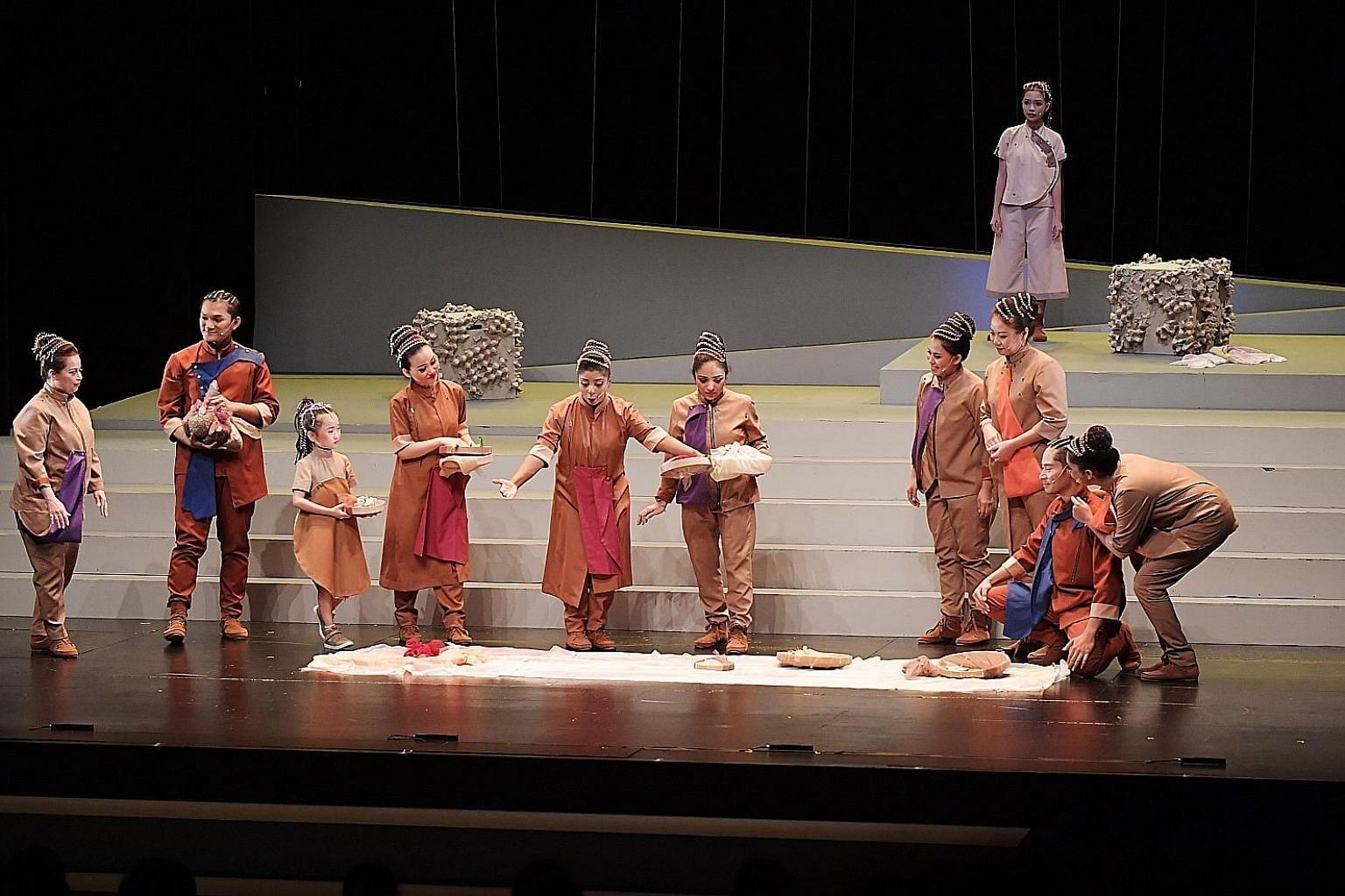 A performance by Singaporeans and new immigrants at the Victoria Theatre yesterday. It was jointly organised by the People's Association Integration Council and the National Integration Council to promote greater integration.