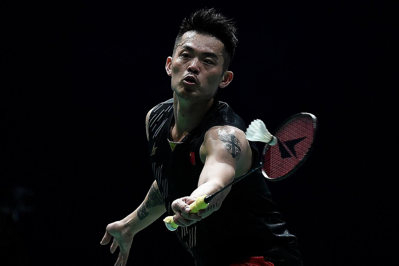 China's Lin Dan hitting a shot against compatriot Chen Long in the men's singles final of the Malaysia Open yesterday. His last victory came at the same tournament in 2017.