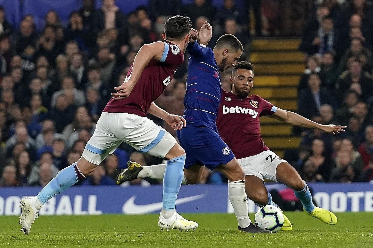 Eden Hazard capping a fine solo run to score Chelsea's opener against West Ham at Stamford Bridge. The Belgian added another to lead the Blues to a 2-0 win and third place in the Premier League.