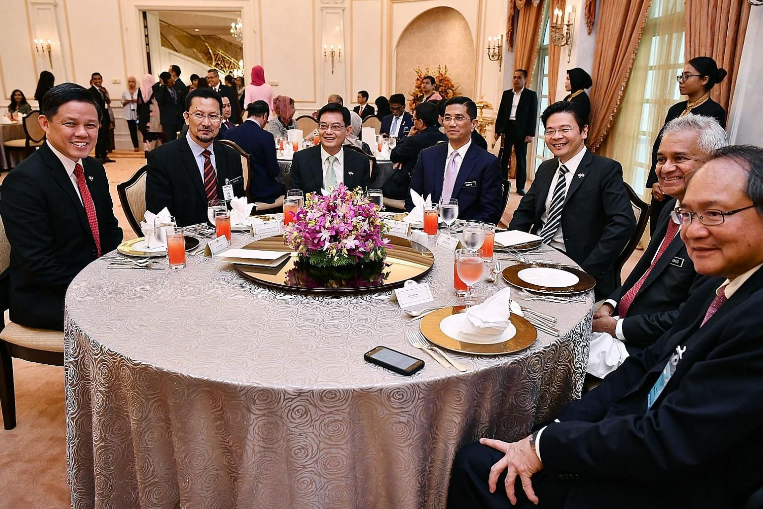 Above, from left: Singapore's Trade and Industry Minister Chan Chun Sing, Malaysia's Economic Affairs Secretary-General Saiful Anuar Lebai Hussen, Singapore's Finance Minister Heng Swee Keat, Malaysia's Economic Affairs Minister Azmin Ali, Singapore'