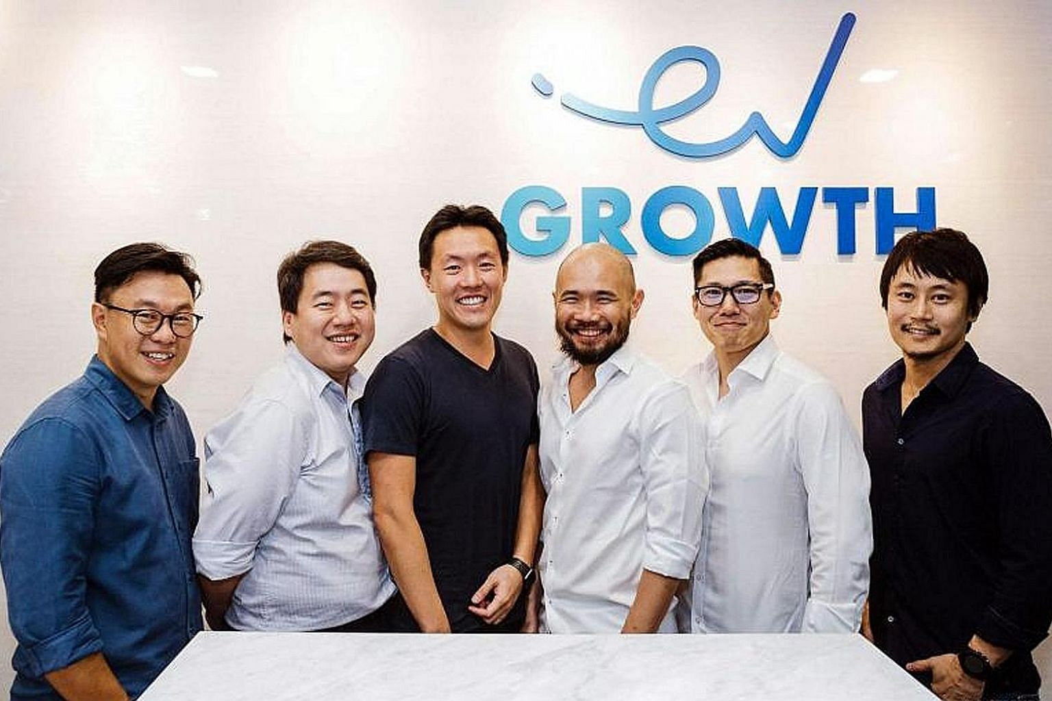 ShopBack chief executive officer Henry Chan (third from left) with the EV Growth team: (from left) managing partners Willson Cuaca and Roderick Purwana, adviser Batara Eto, managing partner Shinichiro Hori and vice-president of investment Yoshi Okubo