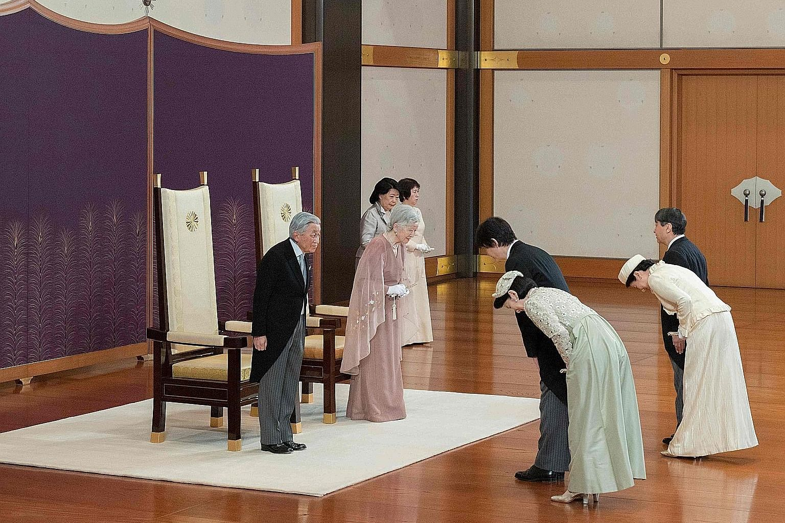 Left: Emperor Akihito and Empress Michiko being congratulated by (from far right) Crown Prince Naruhito, Crown Princess Masako, Prince Akishino and Princess Kiko during the celebration of the 60th anniversary of their wedding yesterday at the Imperia