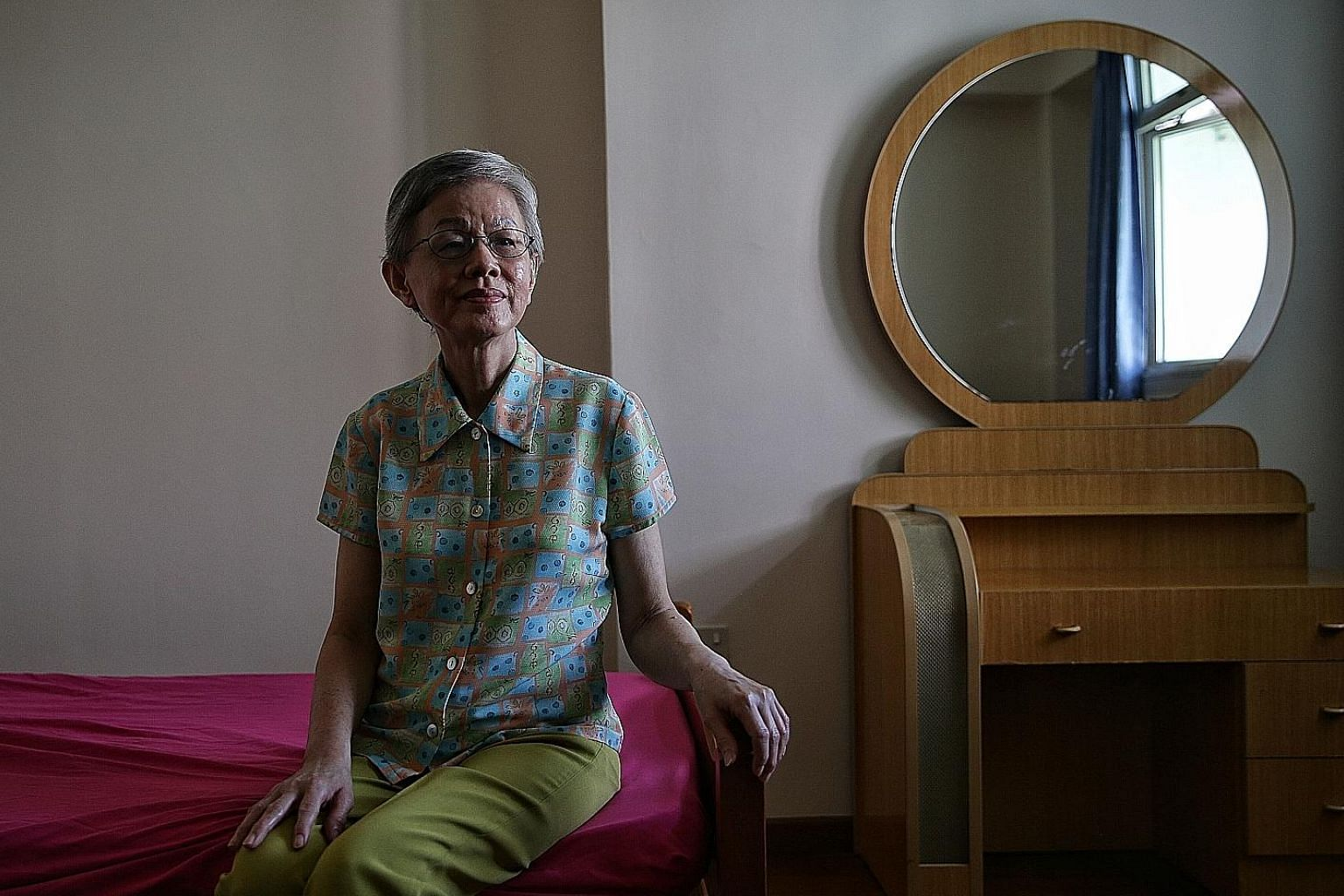 Ms Stephanie Kong was asked to pay a deposit of more than $19,000 to be moved from Singapore General Hospital to Sengkang Community Hospital. ST PHOTO: KEVIN LIM