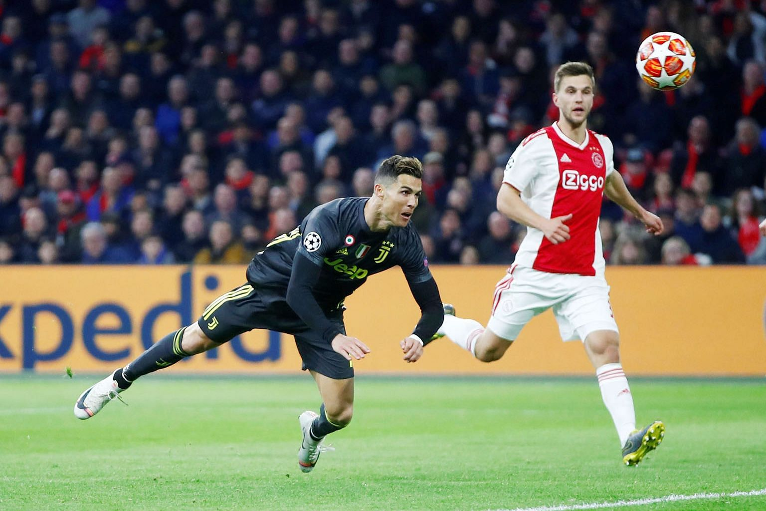 Cristiano Ronaldo scoring with a diving header on the stroke of half-time to give Juventus a precious away goal against Ajax in the 1-1 draw in the Champions League quarter-final first leg in Amsterdam on Wednesday.
