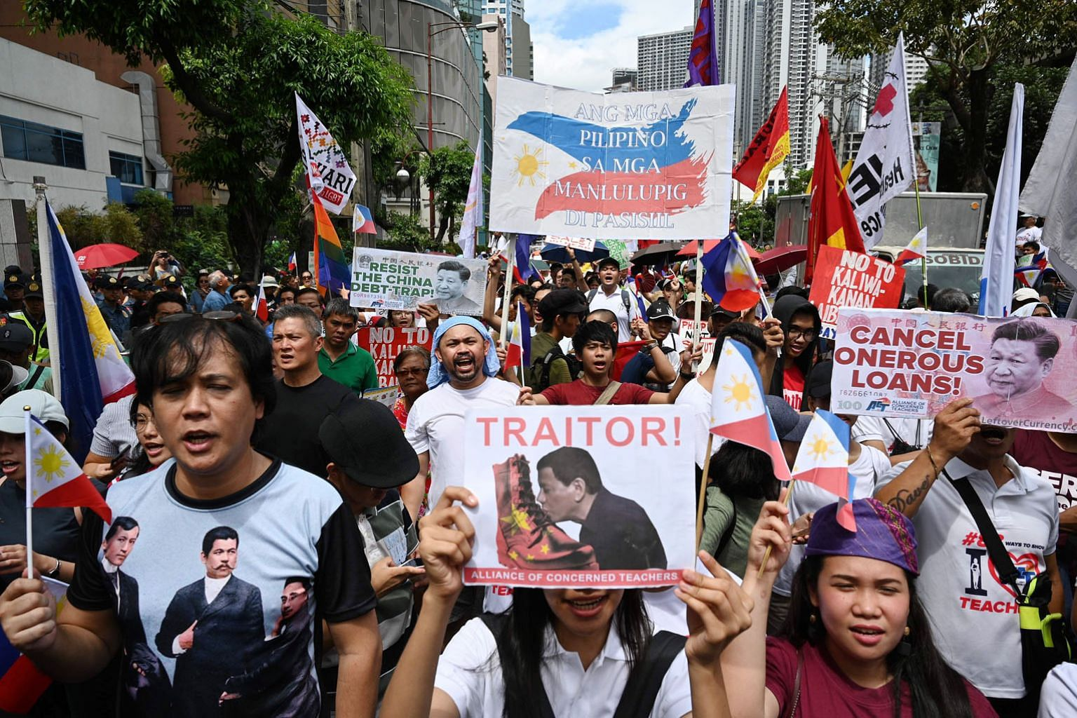 Filipinos in front of the Chinese consular office in the financial district of Manila on Tuesday, protesting against China's growing sway in the Philippines as tensions rise over Beijing's presence in the disputed South China Sea. Over the past three