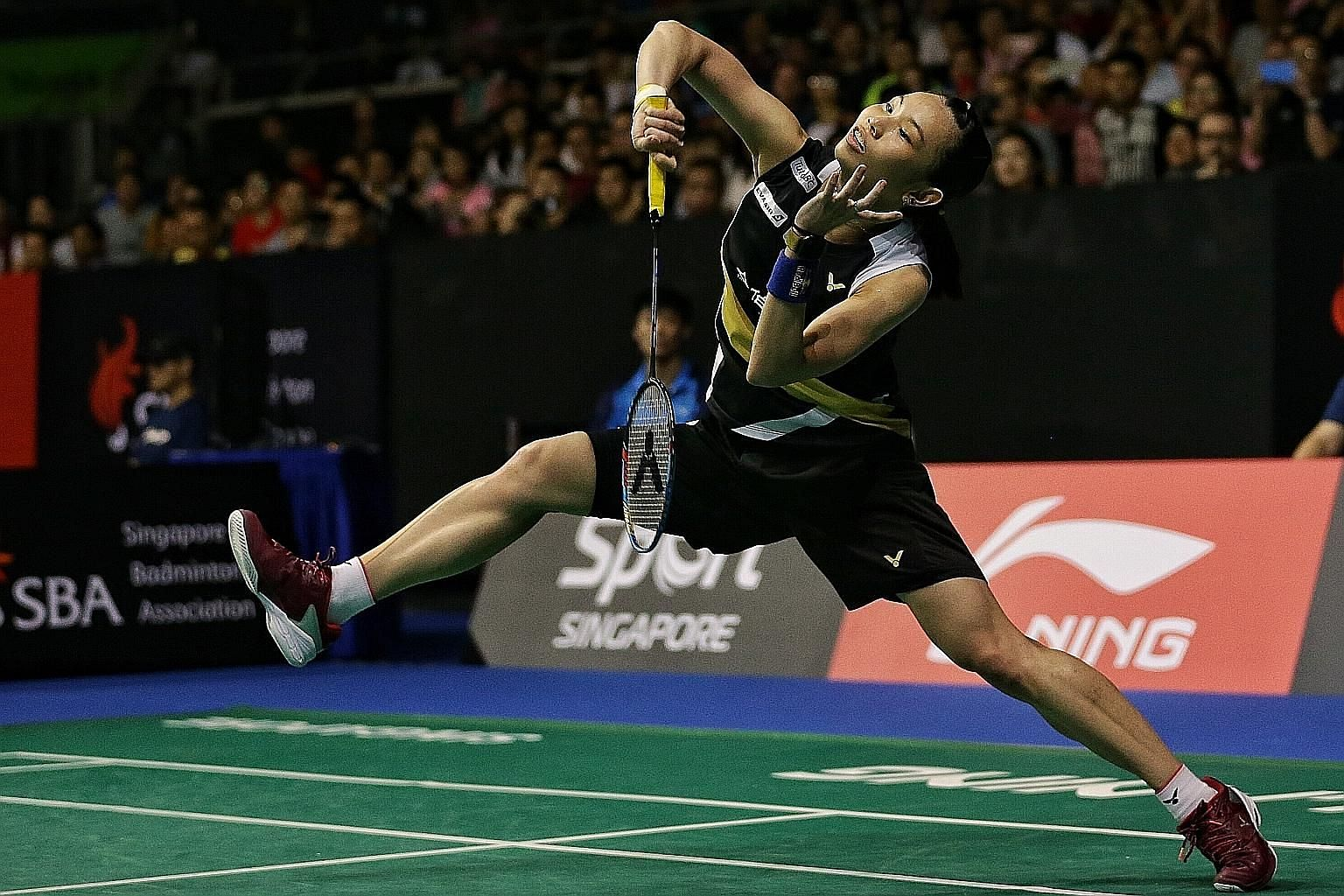 Chinese Taipei's world No. 1 Tai Tzu-ying smashing at Japan's Akane Yamaguchi in their semi-final at the Singapore Indoor Stadium yesterday. She has won their last three meetings.