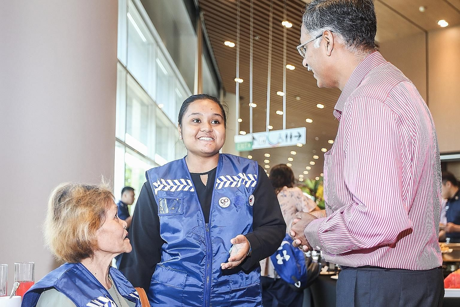 Left: Bukit Batok MP and GPC for Home Affairs and Law deputy chairman Murali Pillai with Citizens on Patrol (COP) volunteer Nur Arfa Muhammad Rahmat, 18, and her mother. Miss Arfa joined the scheme when she was 13. Right: Mr Ganesan Kulandai, 64, was