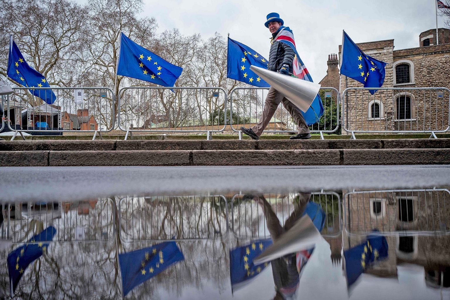 Above: An anti-Brexit protester outside the Houses of Parliament in London on March 4. Left: An anti-Brexit protester taking part in a demonstration in Brussels, Belgium, last Wednesday.