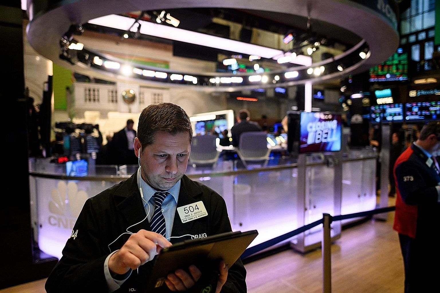 A trader working ahead of the closing bell on the floor of the New York Stock Exchange last month. Even though the US earnings season has kicked into gear, traders will also be listening in on developments from the US and Japan trade talks today and