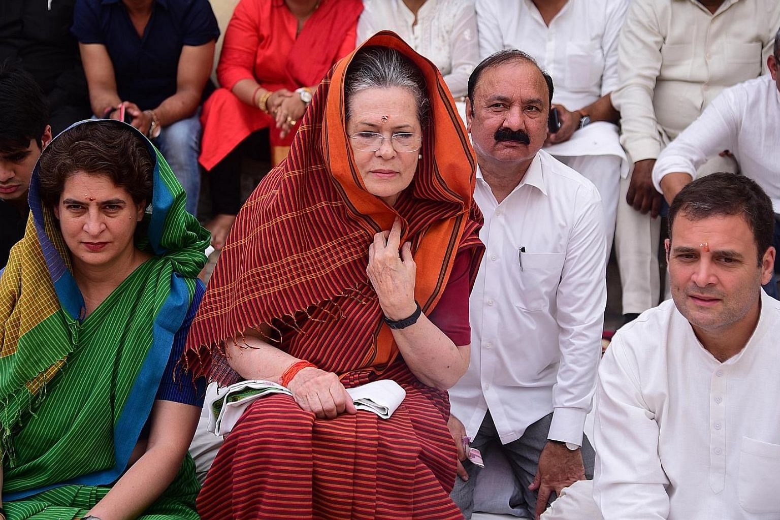 Former Congress party president Sonia Gandhi (centre), her daughter and party member Priyanka Gandhi (left), and her son, Congress president Rahul Gandhi (right), attending a prayer at a temple before filing her nomination papers in Raebareli, Uttar