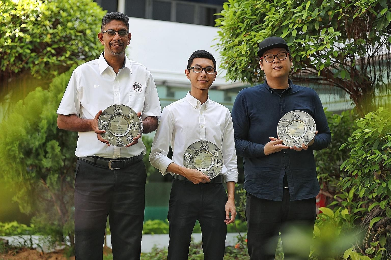 (From left) Mr Satesh Kumar A/L Raman, Mr Muhammad Afiq Roslee and Mr Muhammad Zakaria Rosli with their Public Spiritedness Awards at Bedok Police Division headquarters yesterday.