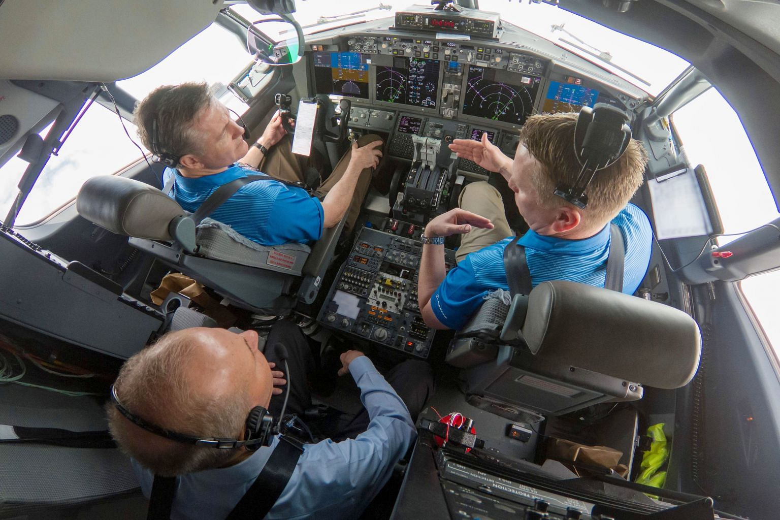 Boeing chief executive Dennis Muilenburg (in rear seat) with two pilots on a flight demonstration this month of the updated Manoeuvring Characteristics Augmentation System software on a 737 Max 7 aircraft. Two recent fatal crashes of the Boeing 737 M