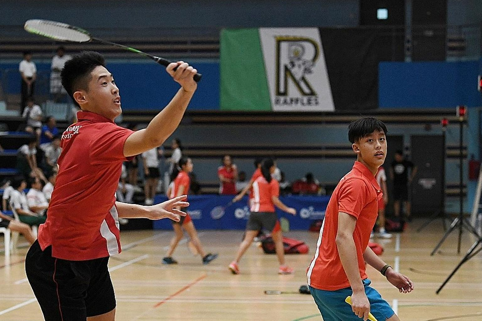Above: SSP's Johann Prajogo (left) and Torance Chee in action during the B Division boys' final. Left: Rennie Yow sealing Singapore Sports School's win in the B girls' final against RGS. ST PHOTOS: KHALID BABA