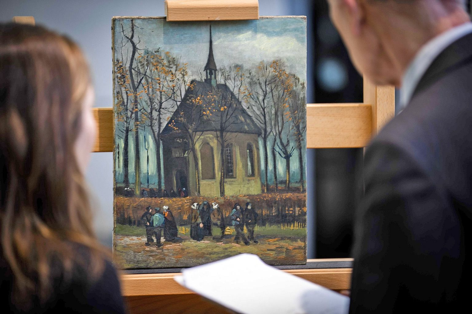 The painting Congregation Leaving The Reformed Church In Nuenen (1885) by Vincent van Gogh (1853-1890) is ready for display in the permanent collection of the Van Gogh Museum in Amsterdam, the Netherlands. Two of van Gogh's works - Seascape Near Sche