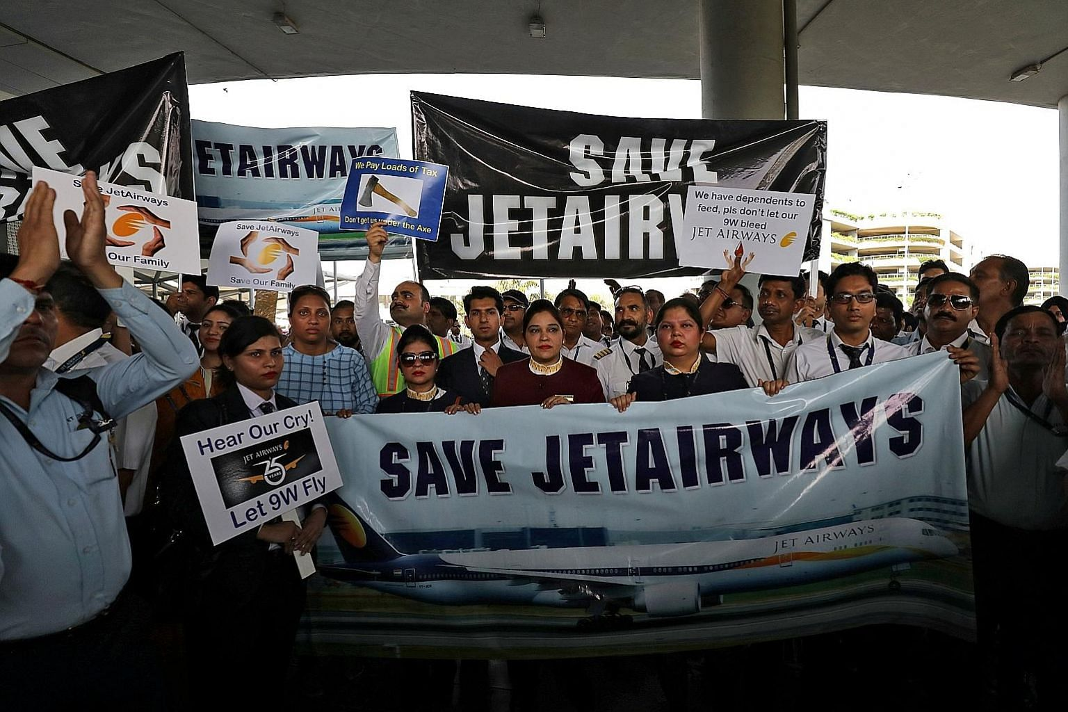 Jet Airways staff staging a protest at the Indira Gandhi International Airport, in New Delhi, last Saturday. The debt-ridden airline is seeking an immediate injection of four billion rupees (S$77.8 million) to continue its few remaining services. PHO