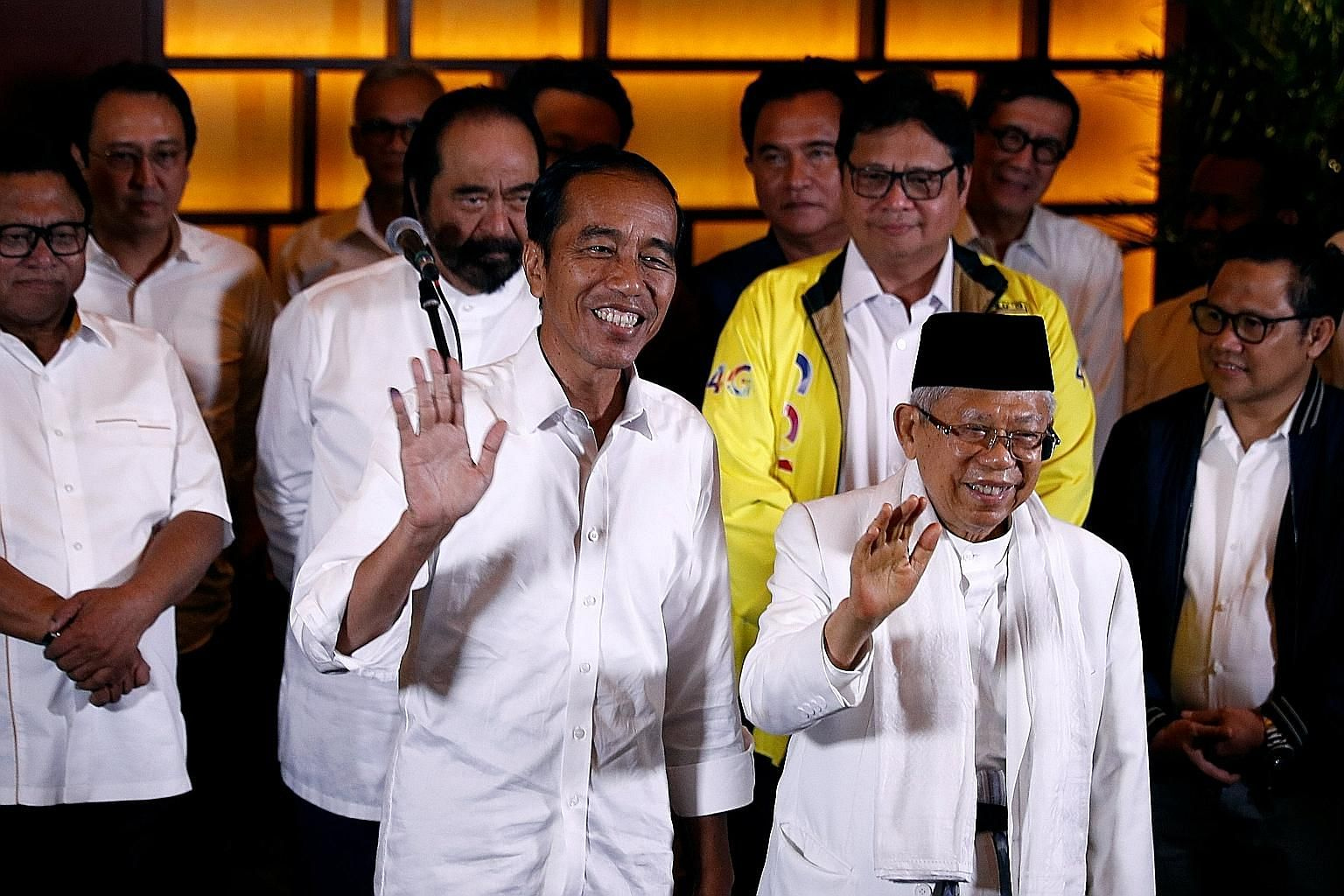 President Joko Widodo (left) and his running mate Ma'ruf Amin reacting to the quick-count results yesterday. Mr Joko called for national solidarity and appealed to his supporters to keep a low profile, following bitter elections that saw quarrels amo