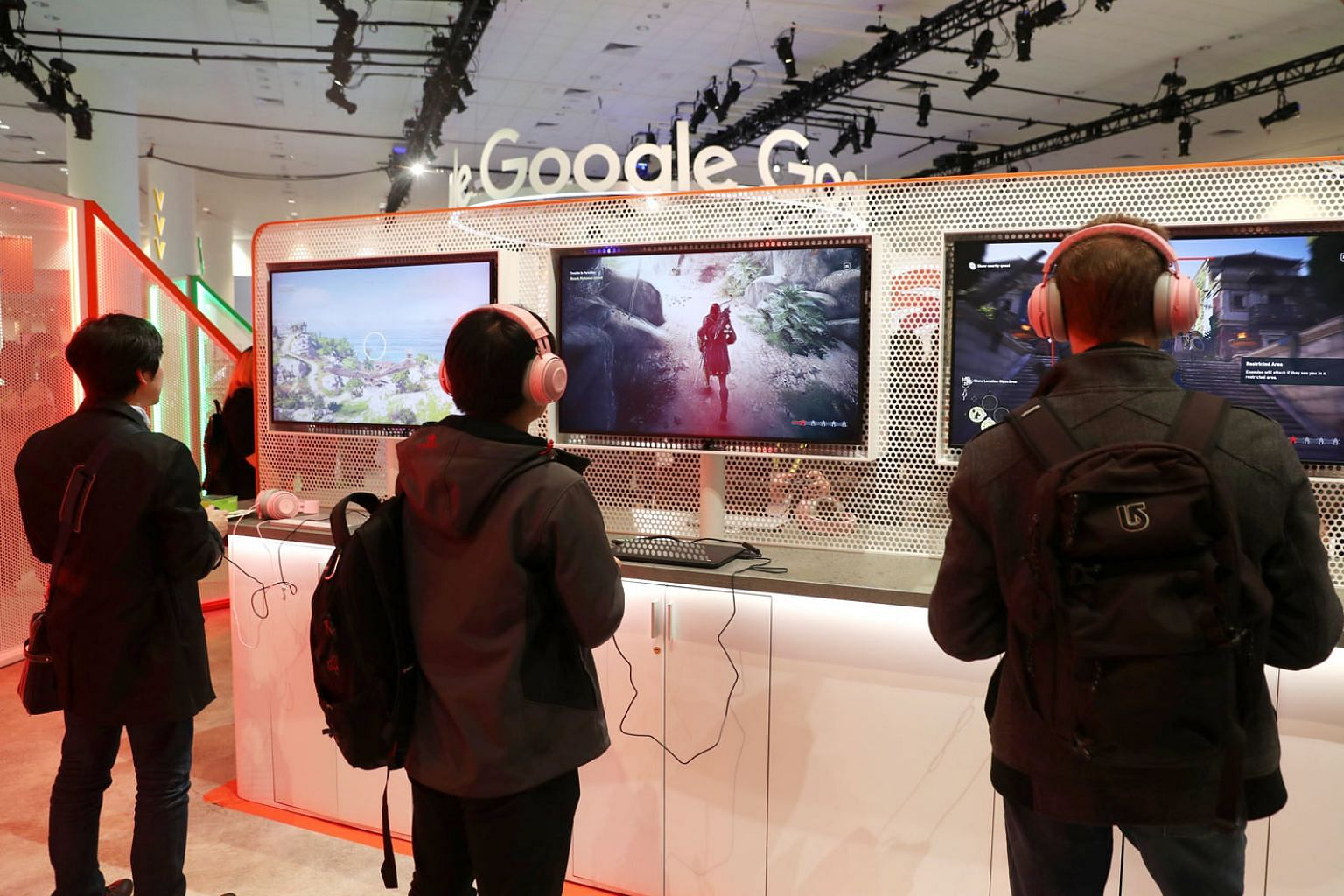 Attendees at the 2019 Game Developers Conference last month playing games at the Google booth in San Francisco, California. Google is, via the cloud, making a big bet on gaming - recalling China's gaming and investment tech conglomerate Tencent.